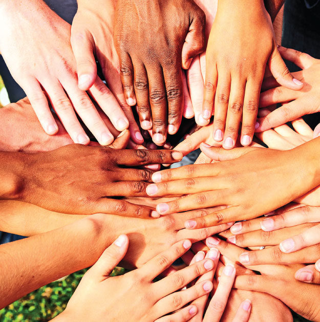 Photo of hands together in unity